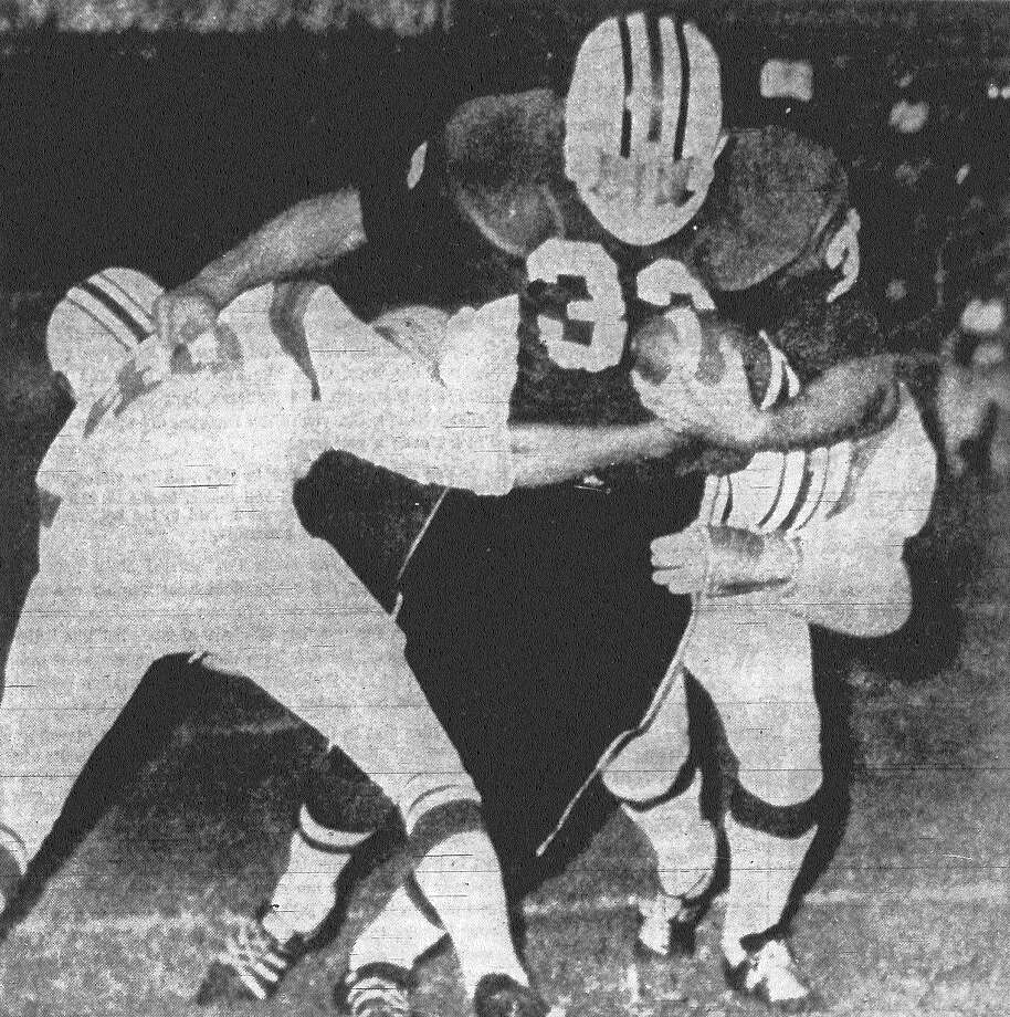 San Antonio Toros running back Fred Frieling bulls his way up the middle for a four-yard grain in this first period action at Alamo Stadium. Frieling carried the two Omaha defenders for two extra yards. The Toros won 30-3. Published in the San Antonio Express Aug. 18, 1968. Photo: File Photo