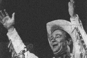 """Roy Rogers whoops it up at HemisFair, ending the program with the cowboy star's old song signature, """"Happy Trails to You."""" Published in the San Antonio News Aug. 14, 1968."""