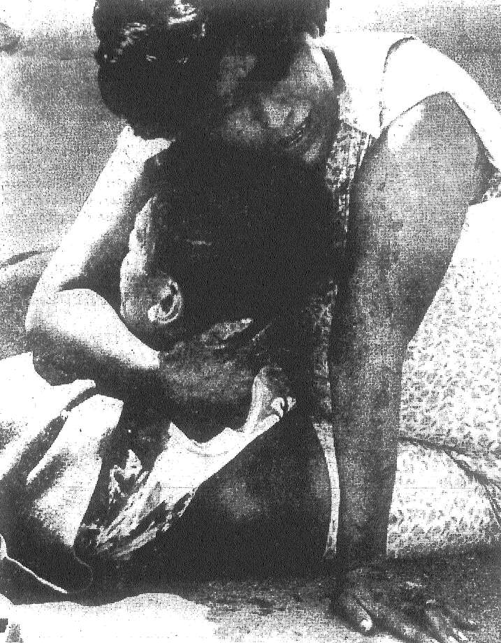 A weeping Mrs. Julian Salazar holds her fatally injured son, Antonio, 13, who was struck by a car while riding a pony on FM 2536 near his home. The pony was also killed. Published in the San Antonio Light Aug. 25, 1968. Photo: File Photo