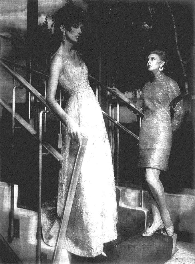 Posed against the stairway at the San Antonio Country Club, two San Antonio professional models, Patti (left) and Faith, show exciting fashions from designers Malcolm Starr and Anne Fogarty collections to be importantly featured in Frost's style show at the Gotham Gala. Published in the San Antonio Light Aug. 25, 1968. Photo: File Photo