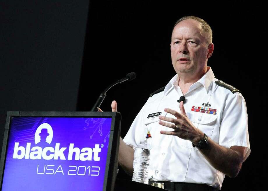 Army Gen. Keith Alexander, head of the National Security Agency, speaks at the Black Hat hacker conference in Las Vegas. Photo: Isaac Brekken / Associated Press