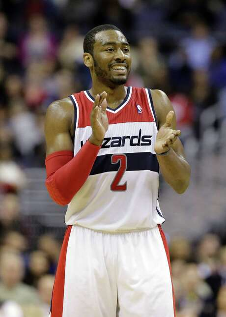 The Wizards' John Wall averaged a career-high 18.5 points along with 7.6 assists last season.