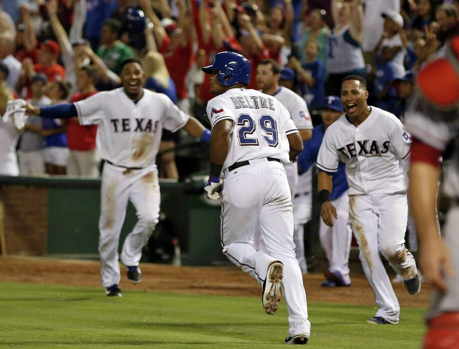 Texas' Adrian Beltre begins his home-run trot in the Rangers' third consecutive walk-off win over L.A. The last club to win three straight on game-ending homers was the 2004 Tigers. Photo: Jim Cowsert / Associated Press