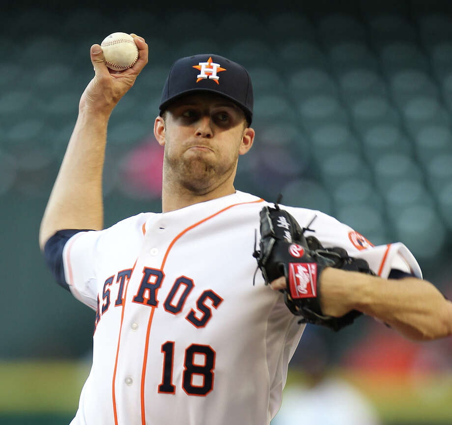Houston Astros starting pitcher Jordan Lyles (18) pitches during the first inning of an MLB game at Minute Maid Park on May 7, 2013, in Houston. ( Karen Warren / Houston Chronicle ) Photo: Karen Warren, Staff / © 2013 Houston Chronicle