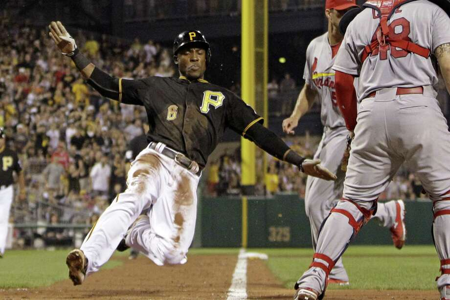 Pittsburgh's Starling Marte scores from third on a sacrifice fly in the fifth inning against St. Louis. Photo: Gene J. Puskar / Associated Press