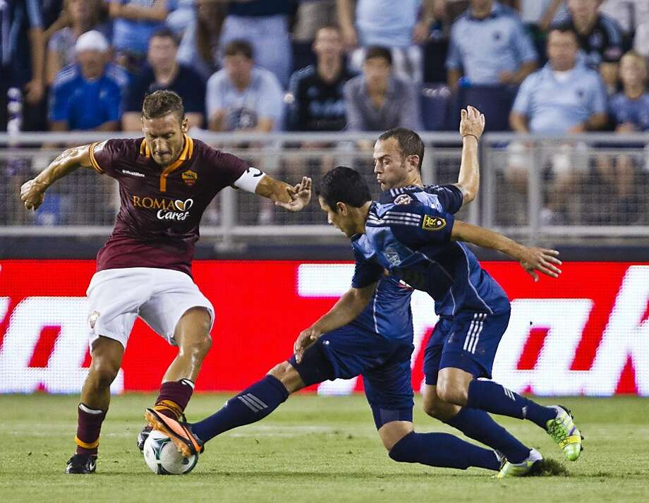 MLS All-Star Brad Davis (center) tries to keep the ball from AS Roma's Francesco Totti in a 3-1 loss. Photo: Shane Keyser, McClatchy-Tribune News Service
