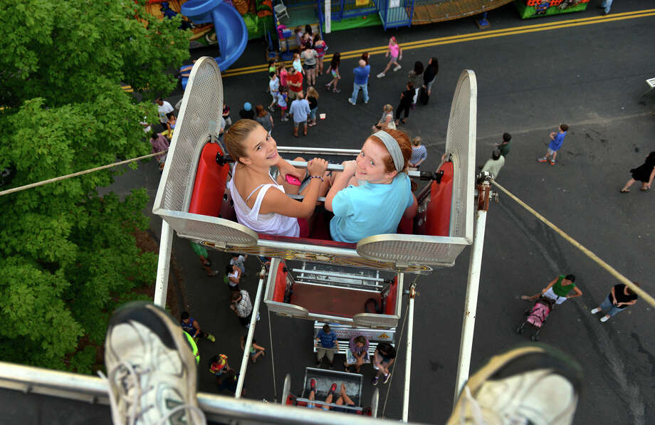 Francie Tesei, 12, left, and her friend Lindsey Flavell, 12, both of Trumbull, ride the Ferris Wheel at the 78th Annual Easton Fireman's Carnival in Easton, Conn. on Wednesday July 31, 2013. The carnival continues nightly 6pm-11pm through Saturday August 3, 2013. Photo: Christian Abraham / Connecticut Post