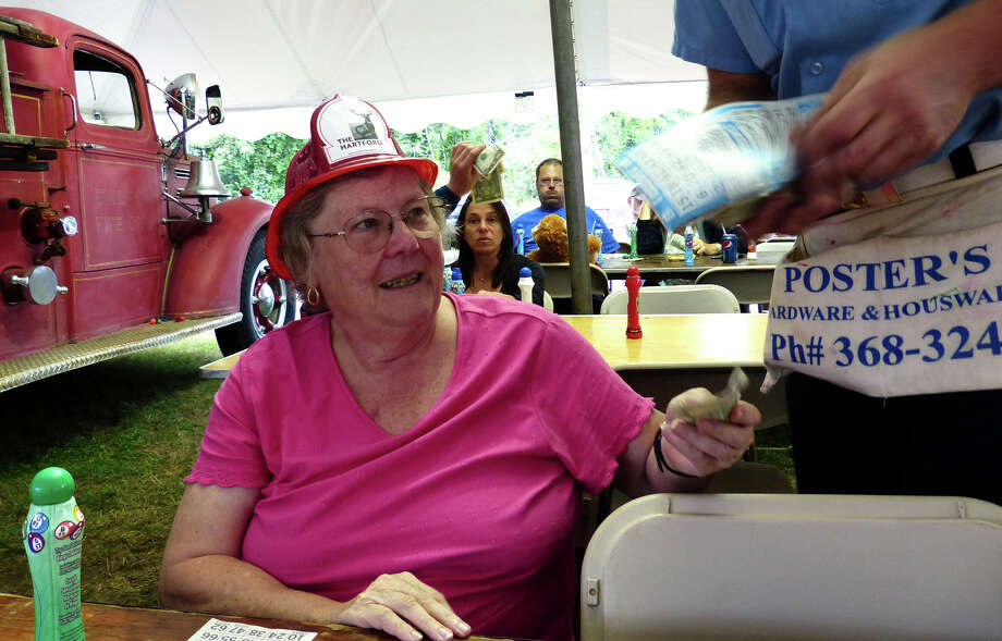 Meta Schroeter, of Weston, buys a new bingo sheet at the 78th Annual Easton Fireman's Carnival in Easton, Conn. on Wednesday July 31, 2013. The carnival continues nightly 6pm-11pm through Saturday August 3, 2013. Photo: Christian Abraham / Connecticut Post