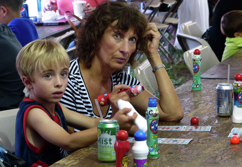 David Parniawski, 5, of Shelton, plays bingo with his grandmother Charlotte, at the 78th Annual Easton Fireman's Carnival in Easton, Conn. on Wednesday July 31, 2013. The carnival continues nightly 6pm-11pm through Saturday August 3, 2013. Photo: Christian Abraham / Connecticut Post