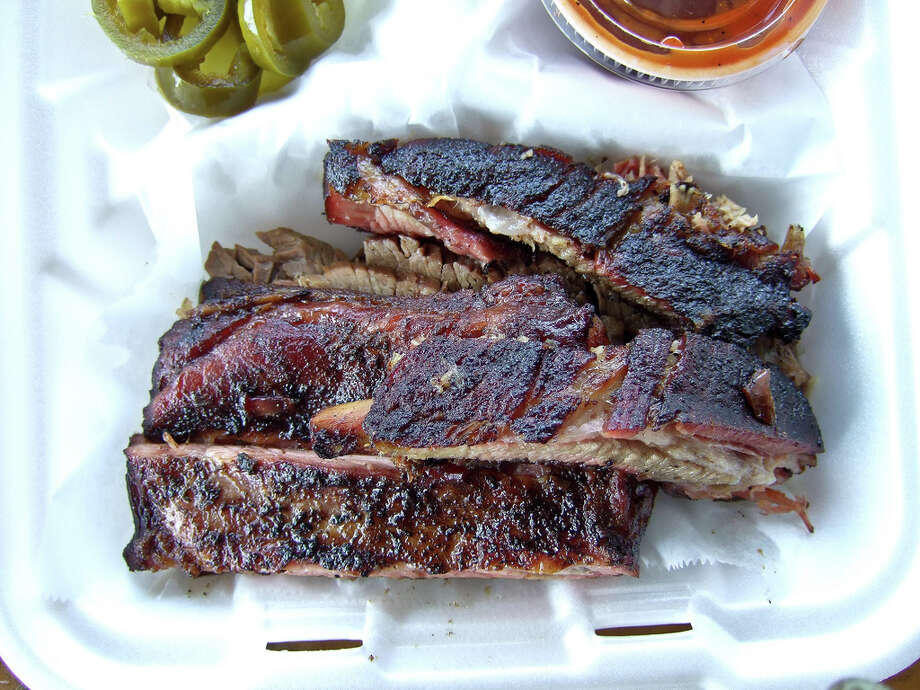 Mardi Gras is a day to indulge and celebrate before the Lenten season, which begins on Wednesday. And when we think indulge, we think Houston barbecue, burgers, enchiladas, ice cream and pizza. Here are some of our favorites. Barbecue ribs from Gatlin's, 1221 W. 19th Street in Houston. Photo: J.C. Reid