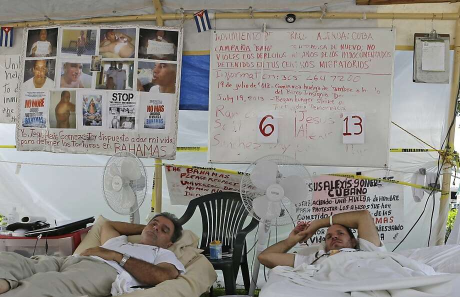 Ramon Saul Sanchez, left, president of the Democracy Movement, and Jesus Alexis Gomez lie in bed during a hunger strike in Miami, Wednesday, July 31, 2013. Sanchez and Gomez are protesting the abuse of undocumented Cubans detained in the Bahamas. (AP Photo/Alan Diaz) Photo: Alan Diaz, Associated Press