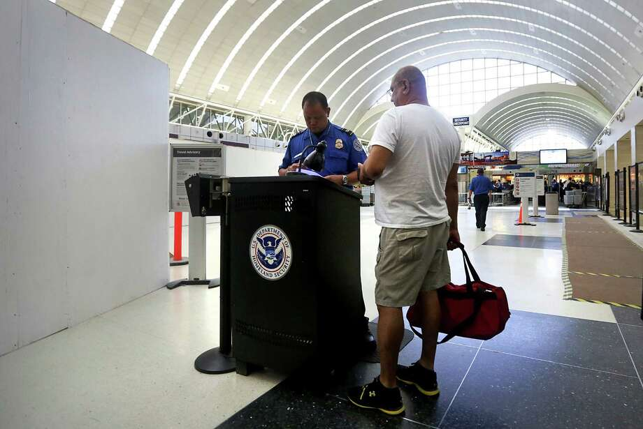 Because of ongoing renovations at Terminal A of the San Antonio International Airport, the security checkpoint area has been temporarily moved to put in a new floor, on Tuesday, July 30, 2013. Photo: Bob Owen, San Antonio Express-News / © 2012 San Antonio Express-News