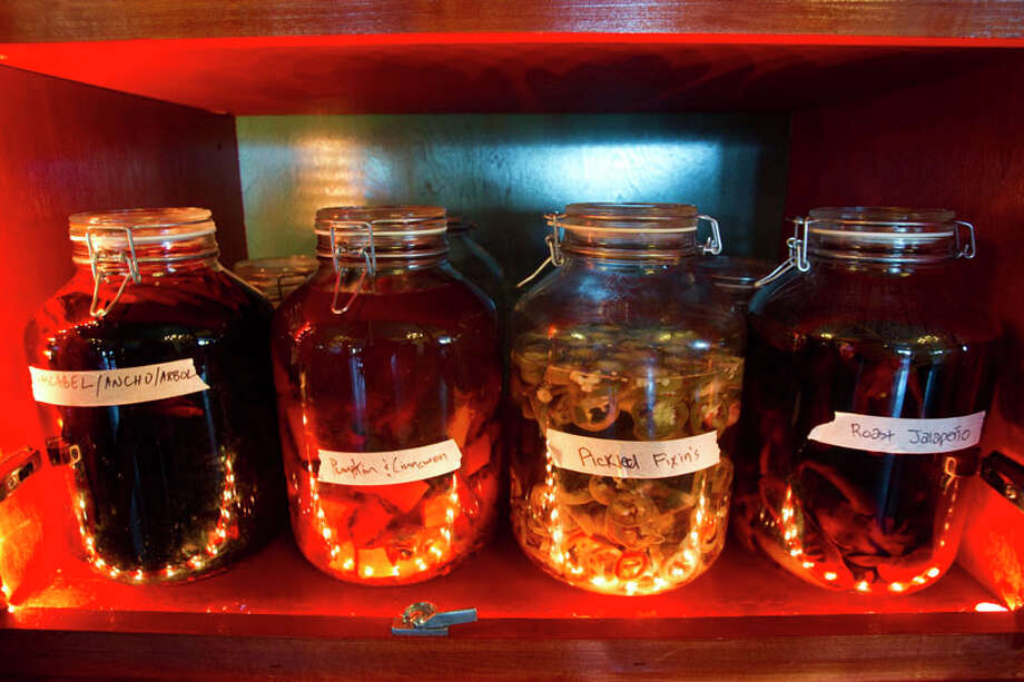 Jars of tequila being infused with various flavors are shown at El Gran Malo. Photo: Brett Coomer, Houston Chronicle / © 2011 Houston Chronicle