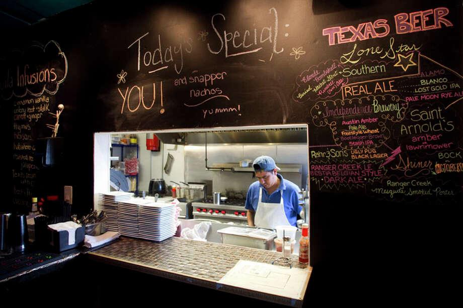 The kitchen of El Gran Malo. Photo: Brett Coomer, Houston Chronicle / © 2011 Houston Chronicle