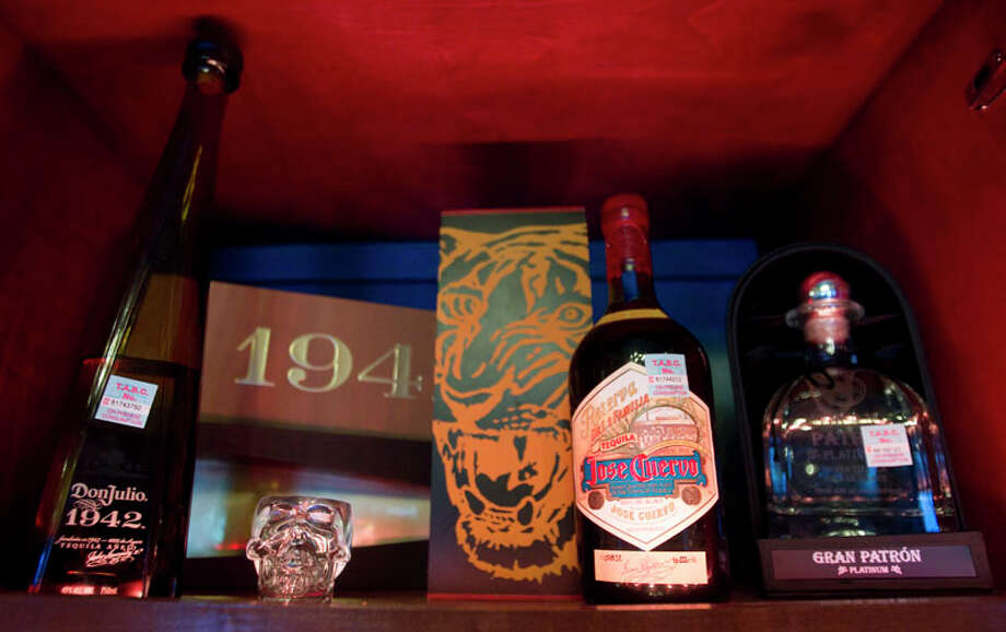 Tequila bottles are on display at El Gran Malo. Photo: Brett Coomer, Houston Chronicle / © 2011 Houston Chronicle