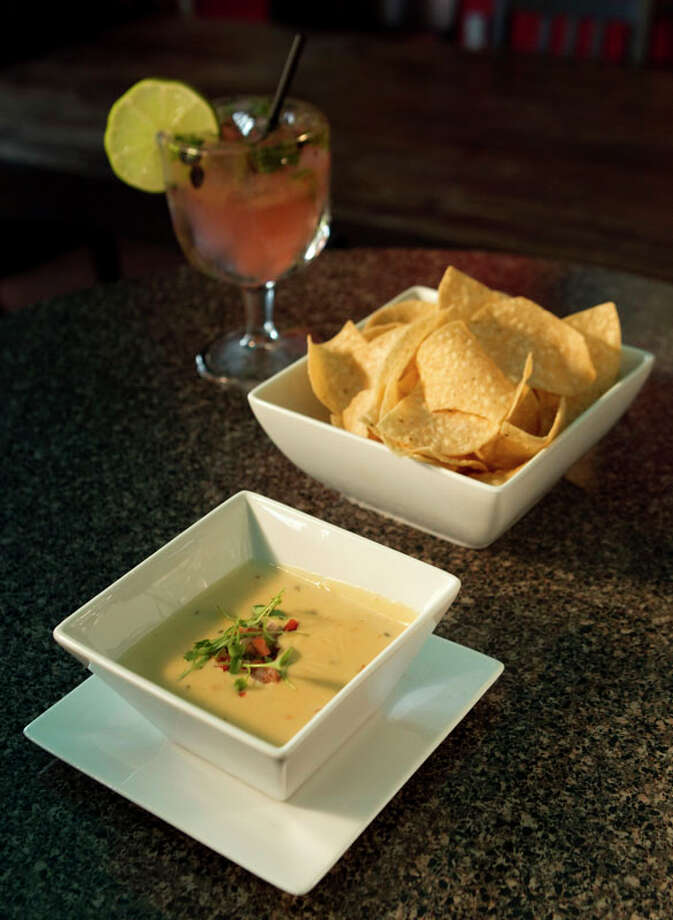 Chips and queso are shown with a blueberry, jalapeño, cilantro margarita are shown at El Gran Malo. Photo: Brett Coomer, Houston Chronicle / 2011 Houston Chronicle