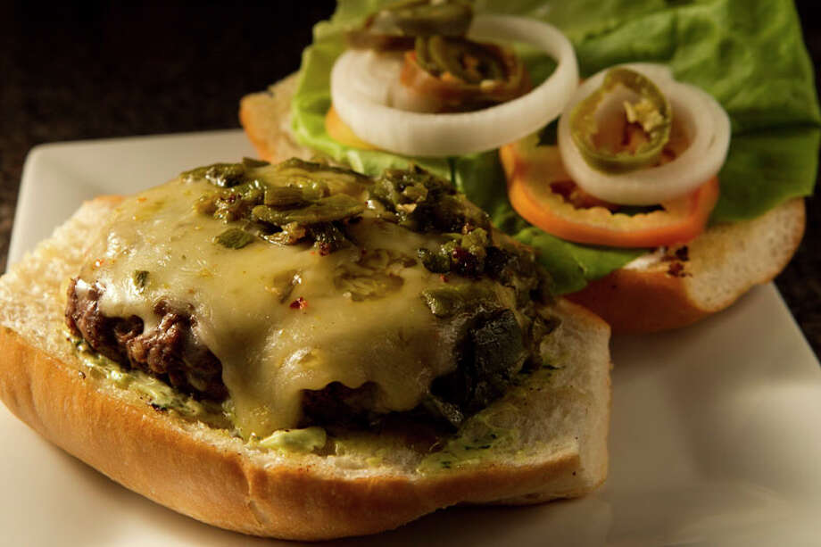A torta, El Gran Malo's version of the hamburger. Photo: Brett Coomer, Houston Chronicle / 2011 Houston Chronicle