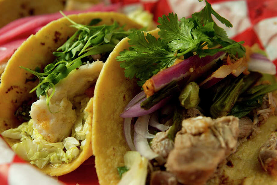 The snapper, pork belly and carnitas tacos are shown at El Gran Malo. Photo: Brett Coomer, Houston Chronicle / 2011 Houston Chronicle