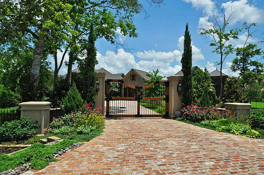 Private gate leads to a crushed granite, circle drive.See the listing here.