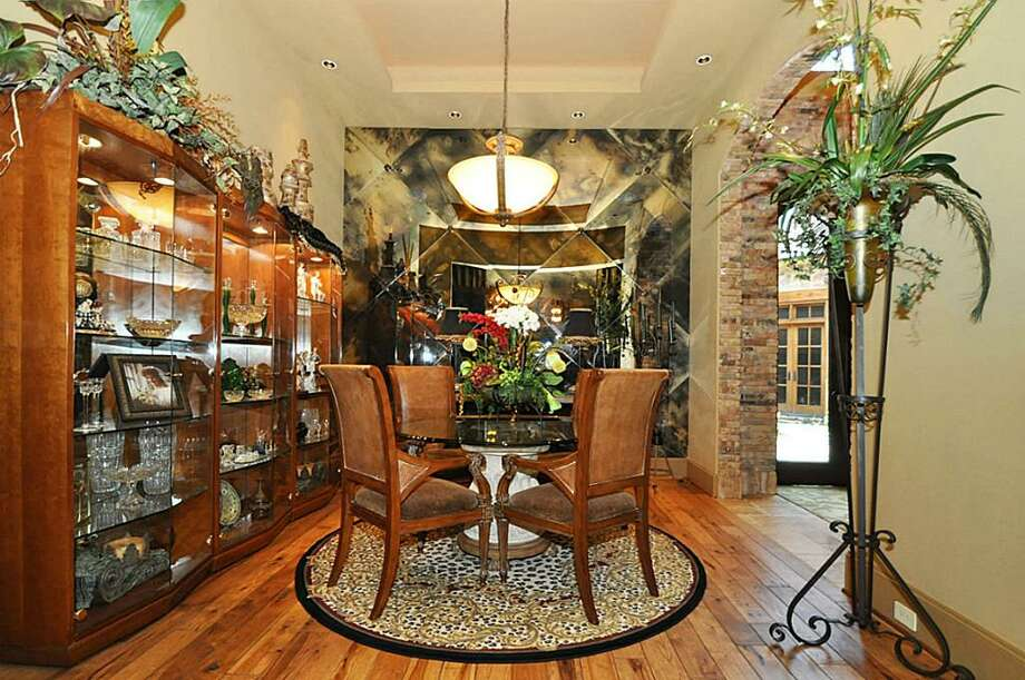 Fabulous formal dining room with custom smoked glass & pecan wood floors.See the listing here.