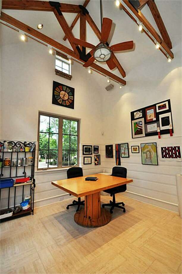 This unique art room features stunning beamed ceilings w/art lighting, unique tile floors, views of the courtyard, & full bathroom w/closet. Could be used as bedroom or guest suite.	