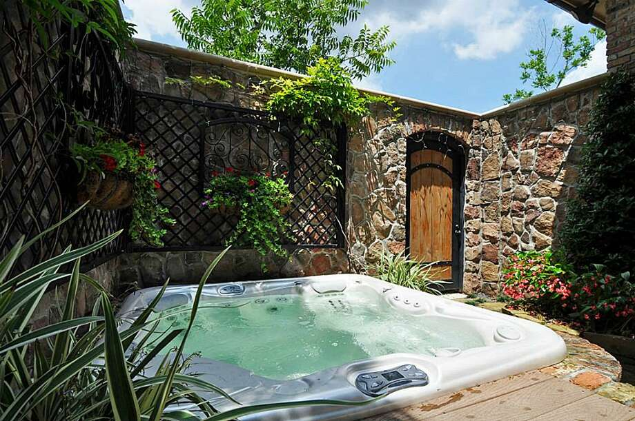 Private spa tucked away for ultimate relaxation! Accessed through the master suite or garden gate. Fully AV system allows for TV viewing while relaxing. Custom evening lighting.  See the listing here.