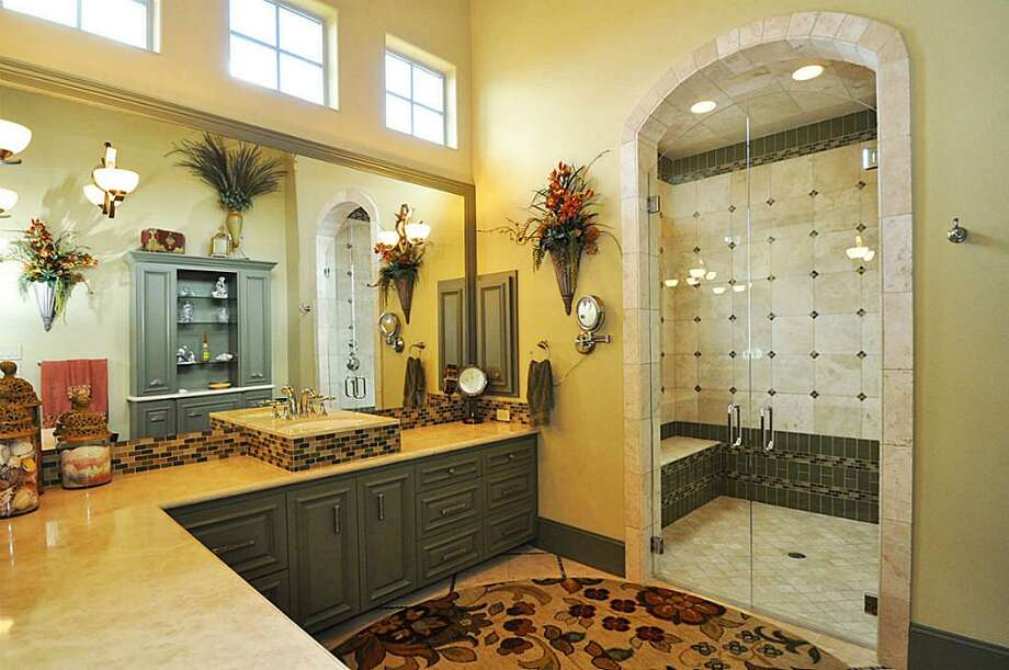 In-law suite bathroom area is spacious & bright. Large walk-in shower & closet, fully laundry facility, multiple storage areas. All ADA compliant.See the listing here.