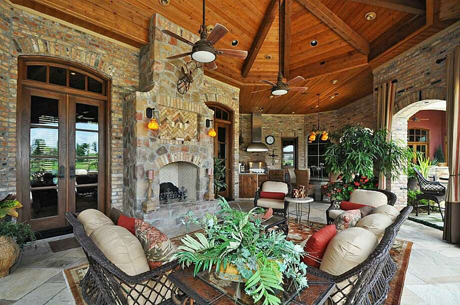 Inviting loggia overlooking the pool features outdoor A/C, slate flooring, large stone fireplace w/media center & boasts panoramic waterfront views. Ideal location for entertaining large parties.See the listing here.