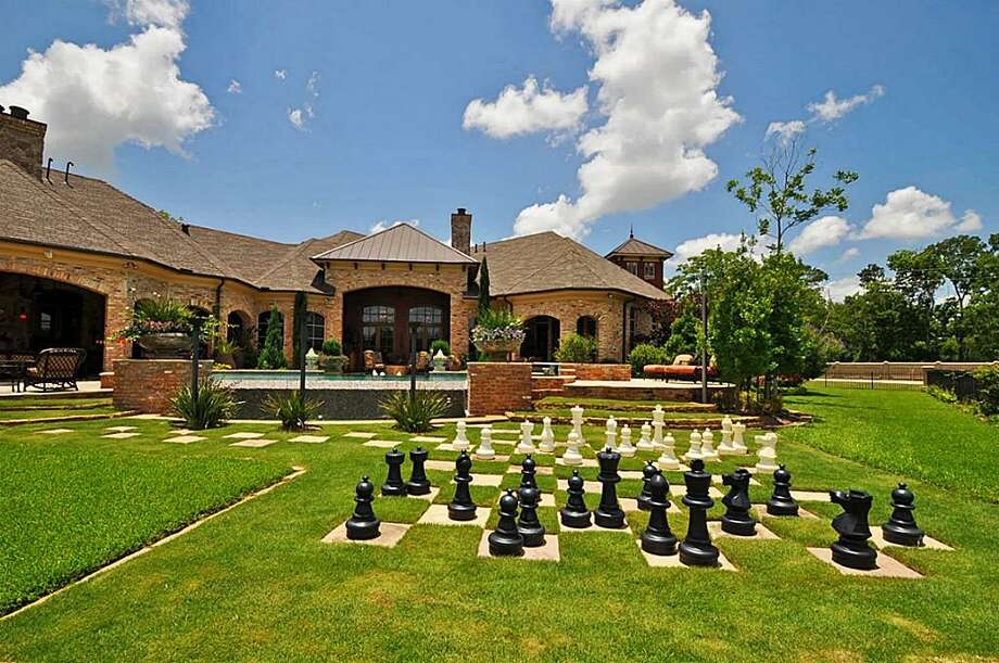 The grounds of 10 Retreat Boulevard offer many amenities. A game of chess is just one of the many entertainment options at this beautiful estate.