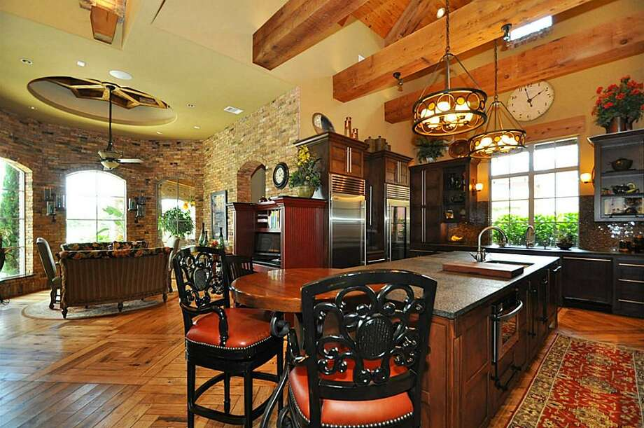 Gourmet kitchen impeccably designed w/large Uba Tuba granite island w/built in vegetable steamer & Sub Zero Wolf appliances.See the listing here.