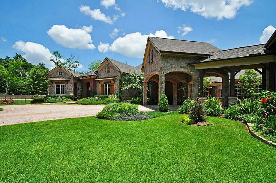 This one story ranch estate has custom landscaping to maximize views from the home.See the listing here.