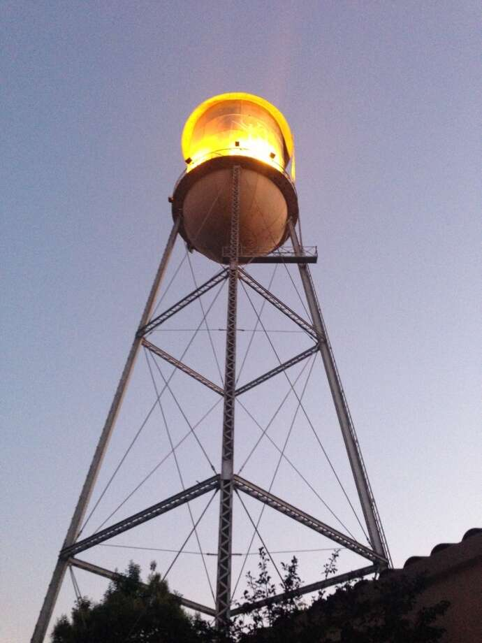 The water tower photographed from the dining patio