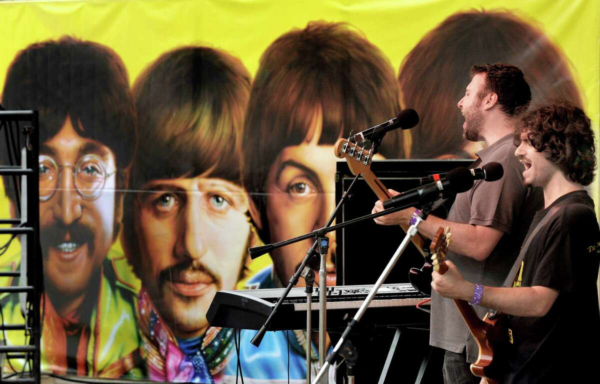 """The band Genetic Control plays a psychedelic Beatles set onstage at Ives Concert Park during """"Danbury Fields Forever"""" Saturday, July 28, 2012. This all-day music and arts festival returns to the park Saturday, Aug. 3, 2013. from 12 to 8 p.m."""