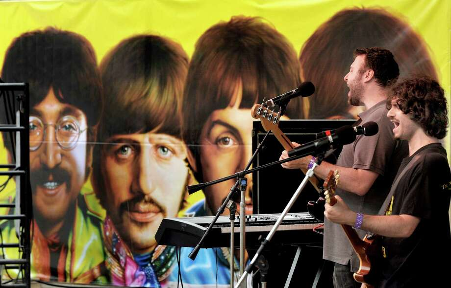 "The band Genetic Control plays a psychedelic Beatles set onstage at Ives Concert Park during ""Danbury Fields Forever"" Saturday, July 28, 2012. This all-day music and arts festival returns to the park Saturday, Aug. 3, 2013. from 12 to 8 p.m. Photo: Michael Duffy / The News-Times"