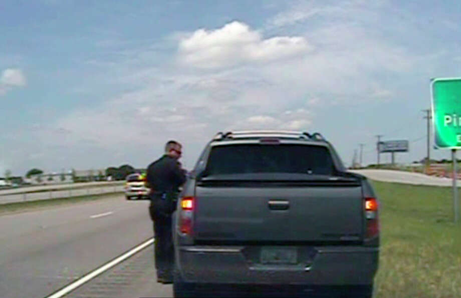 In this image taken from dashcam video provided by Forney police, an officer speaks with George Zimmerman along U.S. 80, about 20 miles east of Dallas, on Sunday. Photo: City Of Forney Police Department