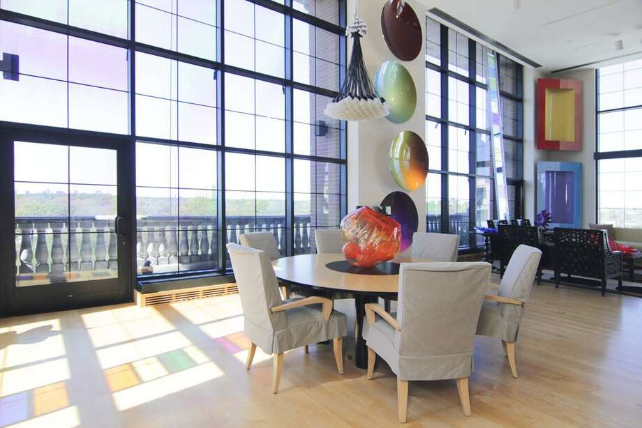 This $2.4 million condo features two bedrooms and three and half baths. It offers stunning views of River Oaks and downtown. See the listing here.
