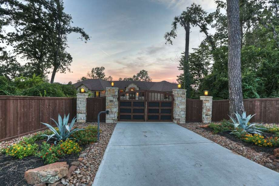 Automatic gate w/intercom. Privacy fencing! Custom designed gates! Steller entrance to your circular drive! Easy to maintain landscaping.See the listing here