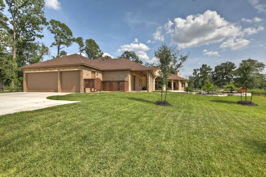 Three car garage offers plenty of parking.See the listing here