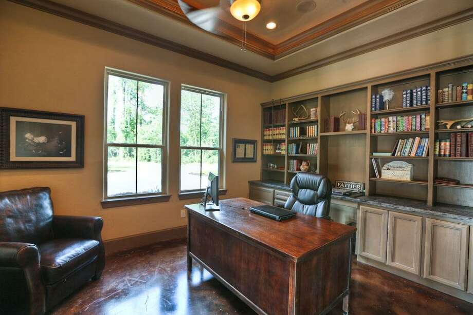 The study is located  just off of the family and dining room area. It features double glass doors and large windows.