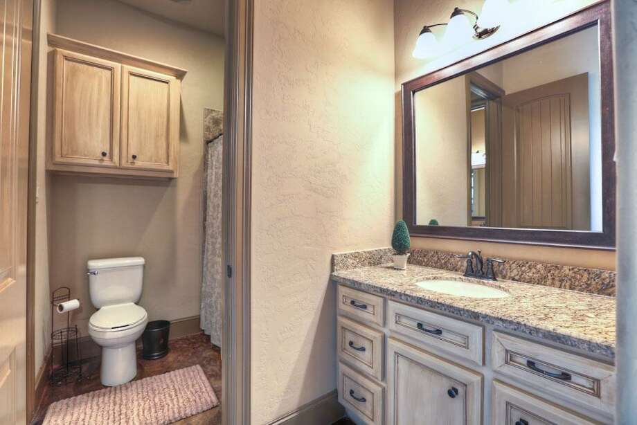 The secondary bathrooms come with a tub, shower and granite top vanities.See the listing here
