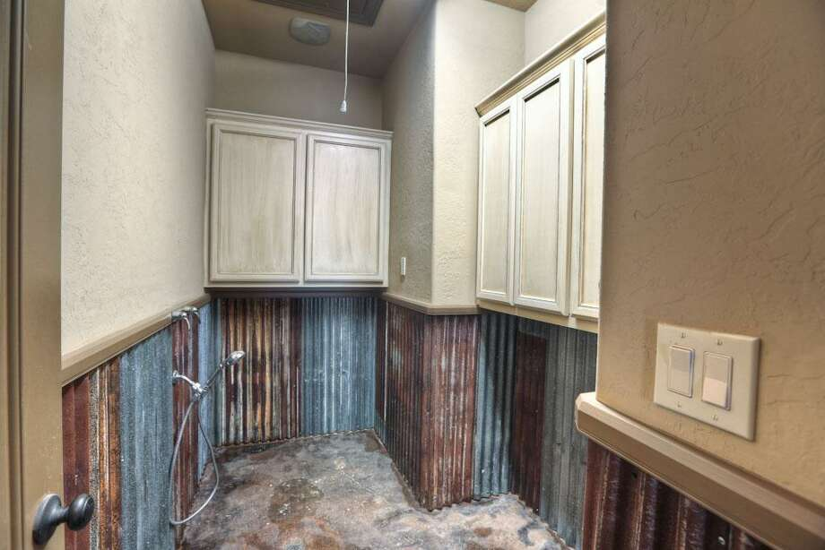 Lots of storage cabinets, also attic access above. You have never seen anything like this, now this could be fun. It'll definitely make pet baths easy.
