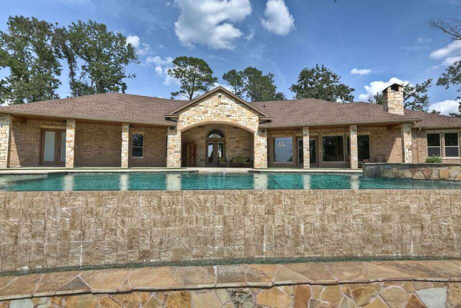 The architecture of this home is something to be admired! The infinty edge pool with cool deck is a perfect addition to this amazing back yard oasis.See the listing here