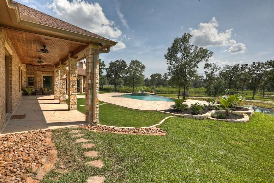 Tastefully landscaped with all the right touches, the entire property is fenced and gated! You have three sets of double glass French doors that can access the patio.See the listing here