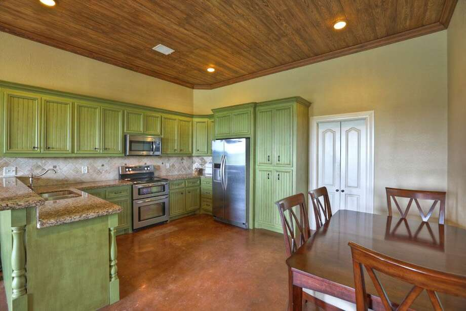 Guest house kitchen w/stainless steel appliances and custom cabinetry.
