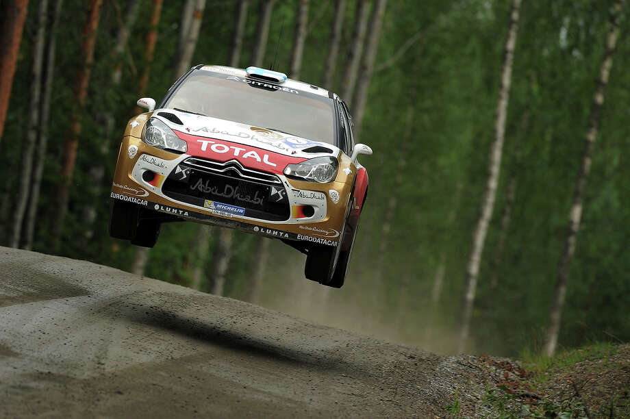 Mikko Hirvonen of Finland and Jarmo Lehtinen of Finland compete in their Citroen Total Abu Dhabi WRT Citroen DS3 WRC during the Shakedown of the WRC Finland on July 31, 2013 in Jyvaskyla, Finland. Photo: Massimo Bettiol, Getty Images / 2013 Getty Images