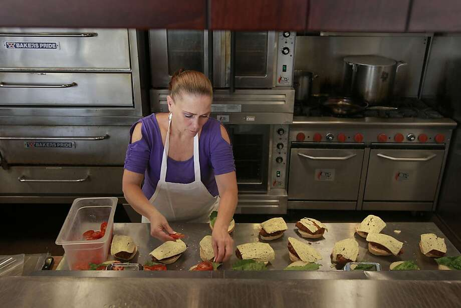 Tammy Price prepares sandwiches at Hayes Valley cafe Bakeworks, which helps its employees retool their lives. Photo: Michael Macor, San Francisco Chronicle