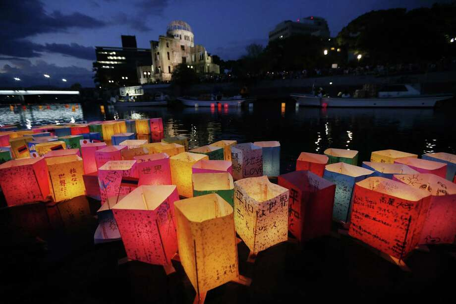 Paper lanterns float along the Motoyasu River in front of the illuminated Atomic Bomb Dome in Hiroshima. Now a thriving city of more than 1 million people, Hiroshima marks the 68th anniversary of the atomic bombing on Tuesday. Photo: Associated Press File Photo