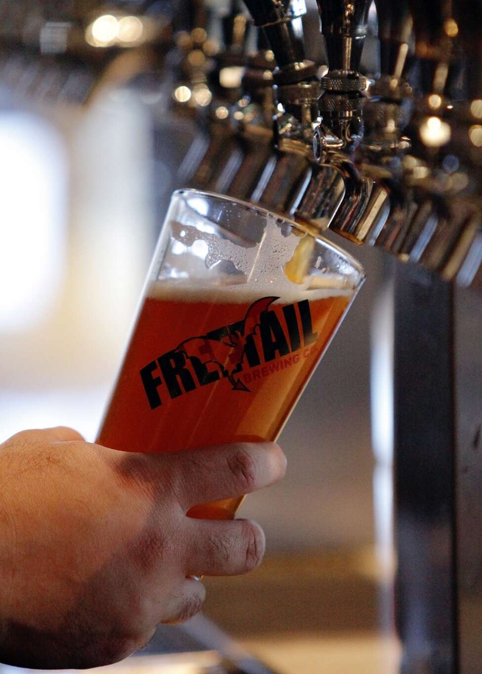 Beer being poured at the Freetail brew pub on the city's North Side.