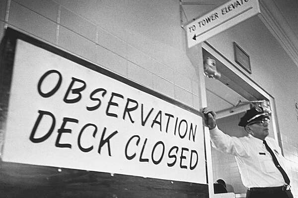 In 1967, a campus police officer keeps visitors out the UT tower's observation deck, which had been temporarily closed. A year earlier, Charles Whitman killed 14 people in and from the tower.