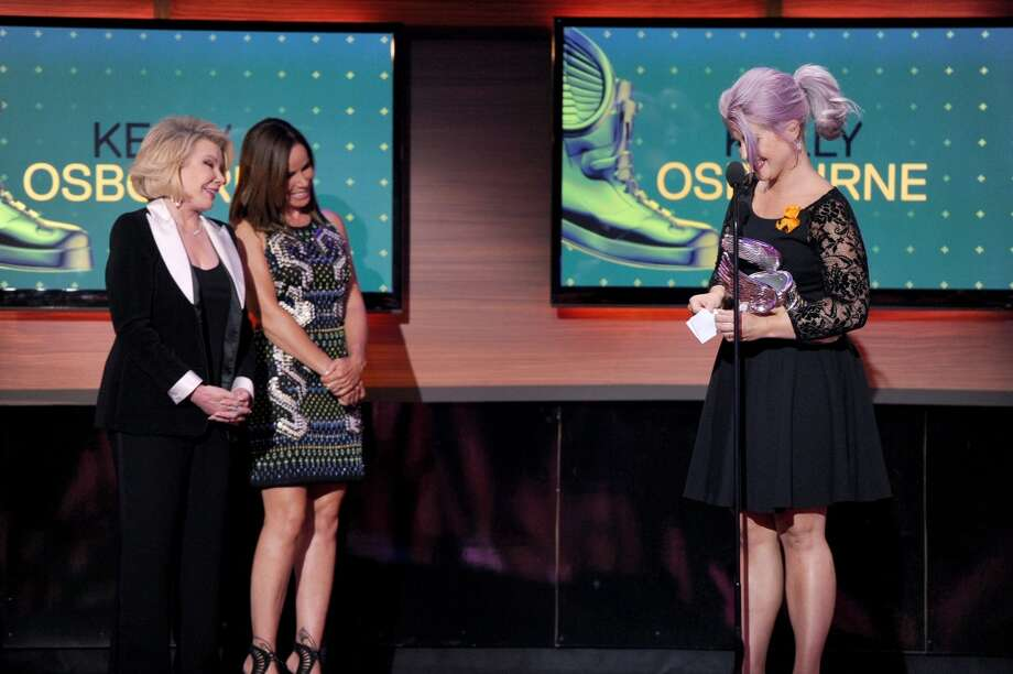 Television personality Kelly Osbourne (R) accepts award from presenters Joan Rivers (L) and Melissa Rivers (C) onstage at the DoSomething.org and VH1's 2013 Do Something Awards at Avalon on July 31, 2013 in Hollywood, California.  (Photo by Kevin Winter/Getty Images) Photo: Kevin Winter, Getty Images